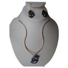 Outstanding iridescent grey Keshi pearl pendant with matching earrings