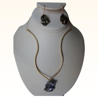 Outstanding iridescent grey Keshi pearl pendant with matching earrings