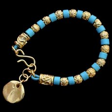 Athena 24K gold over copper and desert blue ceramic bead bracelet