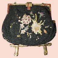 Embroidered beaded handbag
