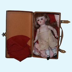 All Bisque German Antique doll with trunk