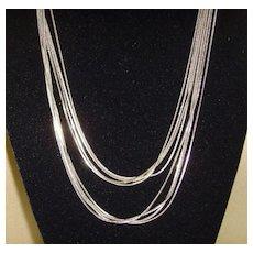 Multi-Stand Silver-Tone Serpentine Fluid Necklace
