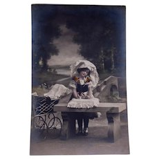 Colored Real postcard Photo- Little Girl with Doll