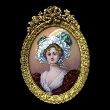 Miniature enamel portrait with gilded frame