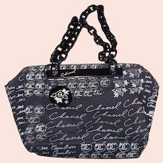 CHANEL France Black Canvas Print Shoulder Bag with Black Lucite Link Straps