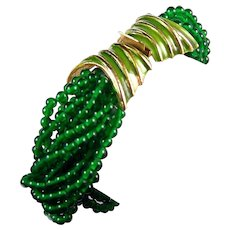 K.J.L. KENNETH J. LANE 1960's 12-Strand Emerald Green Crystal Bead and Enamel Torsade Bracelet