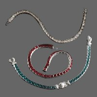 TRIFARI 'Alfred Philippe' Emerald, Ruby, and Diamond Square-cut Invisibly Set Crystals Tennis Bracelets