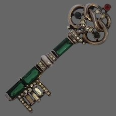 TRIFARI 'Alfred Philippe' Trifari Sterling Gold Scrolled and Emerald Baguettes Skeleton Key Pin