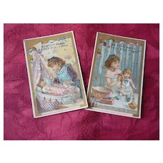 2  pretty 19th C. French shop trade cards : little girls with dolls : Au Petit Paris Ottot Fils Caen