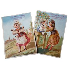 Charming 19th C. French shop advertising trade cards : young girls with dolls : Aux Trois Freres