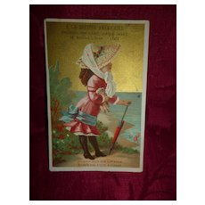 Charming 19th C. French shop advertising trade card : young girl with doll