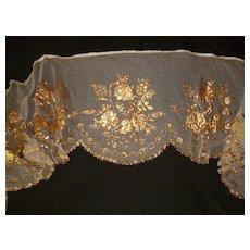 Decorative antique religious tulle : net textile : gilded paper rose floral motifs