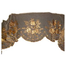 Decorative antique religious tulle : net textile : gilded paper rose floral motifs