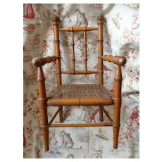 Charming antique French faux bamboo wooden hand caned dolls chair