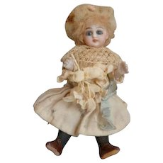 Charming antique swivel head all bisque mignonette doll : blue glass eyes : open mouth : original clothing : 5 inches