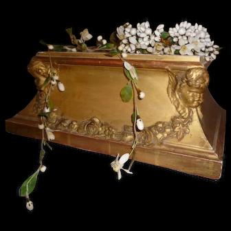 Splendid faded grandeur gilded wood religious plinth : winged cherubs & floral garland motifs : period display