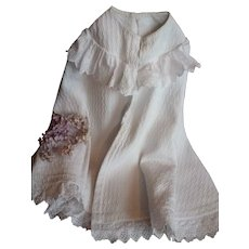 Small child's or large doll's white cape : broderie anglaise lace trim