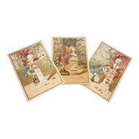 3 amusing antique French Au Bon Marche trade cards : young girl : boy sculpture : doll display