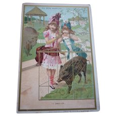 Charming  antique French Au Bon Marche trade card : young girls at the zoo : doll display