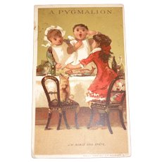 Amusing antique French A Pygmalion trade card : young children, cat & fish bone : doll display