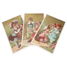3 charming antique French Pygmalion shop trade cards : young girls in fancy costumes & bonnets : doll display