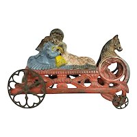 """C. 1880 """"Daisy"""" Cast Iron Bell Pull Toy."""