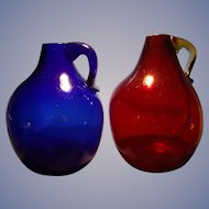 Two Clevenger Handled Jugs
