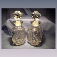 Pair of Early Cologne Bottles in Comet or Snail Pattern