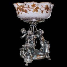 Brides Basket: Extremely Rare White Mother of Pearl Threaded Herringbone Bowl with Pink Interior and Gold Painted Floral Design Sitting Atop Meriden Silver Plated Basket Featuring Three Full Sized Cherubs  at Blacksmith Stands