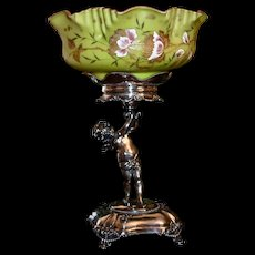 Brides Basket/Centerpiece: Rare Cased Art Glass Brides Bowl Chartreuse Exterior Decorated in Heavy Gold and Enamel Pink & White Roses with Raspberry Pink Interior Sitting Sitting Atop Webster Full Figure Cherub Holder