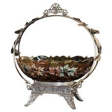 Brides Basket:  Amber Oval Art Glass Coin Drop Brides Bowl With Gold Rim Decorated in Enameled  Autumn Decor Sitting in Ornate James W. Tufts Handled Silverplate Basket
