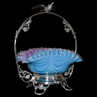 Brides Basket:  Webb Rare Cased Art Glass Nailsea Blue and White Brides Bowl with Pink Interior Sitting in WM Rogers Handled Brides Basket with Bird in Flight