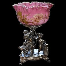 Brides Basket:  Phenomenal Webb Art Cased Melon Ribbed Magnificently Decorated Pink Brides Bowl Sitting Atop Meriden Silver Plated Basket Featuring Three Full Sized Cherubs at Blacksmith Stands.