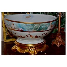 Limoges Incredible Punch Bowl Decorated with Maidens  and Winged Cherubs Sitting Atop Gold Plinth