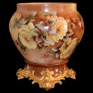 Limoges Outstanding Jardiniere Decorated with Enormous Yellow Roses and Sitting Atop a Stunning Matching Ornately Scrolled Gold Embellished Plinth