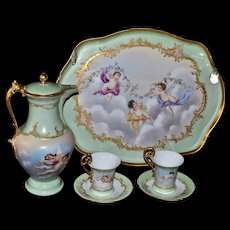 Limoges Spectacular Chocolate Set with Playful Cherubs and Heavy Gold Embellishments