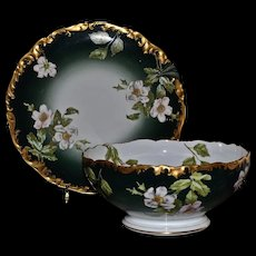 Limoges Center Bowl and Matching Tray/Charger/Underplate With Large White and Pink Tinged Wild Roses Set Against Rich Dark Green Porcelain