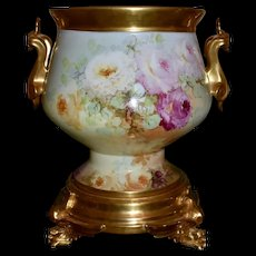 Limoges Extremely Rare Mold Golden Handled Jardiniere Signed Beatrice Carlsson Covered in Exquisite Red, Pink, White and Yellow Roses with Matching Phenomenal Winged Griffin Matching Plinth/Base