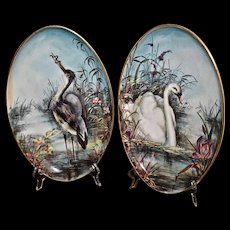 """Limoges Fabulous Signed Pair of Porcelain 14"""" Plaques Depicting Swan and Great Blue Heron in Vibrant Exotic Marsh Like Setting"""