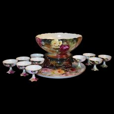Limoges Punch Bowl Set: Rose Covered Punch Bowl with Multi Colored Plinth Together With 10 Gold Rimmed Punch Cups and Large Rose Filled Serving Tray.