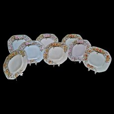 Limoges Set of Eight (8) Octagon Shaped Luncheon Plates in Various Soft Pastel Colors with Yellow, Pink and White Roses