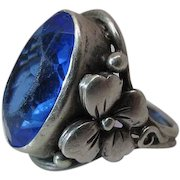 Antique Arts & Crafts Silver Ring With Applied Flowers And Large Blue Glass Stone