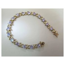 Vintage 10K Yellow Gold 12.75 Carat Tanzanite Trilliant Line / Tennis Bracelet