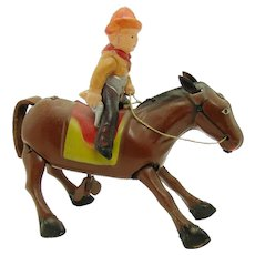 Occupied Japan Tin and Celluloid Cowboy on Horse Wind-up Toy - Near Mint