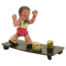 Celluloid Boy Playing Dice Figurine - 1920's