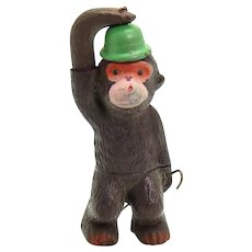 Celluloid Monkey with Twirling Tail and Cane Wind-up Toy