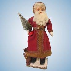 "Father Christmas, German Celluloid head, straw stuffed body 14"""