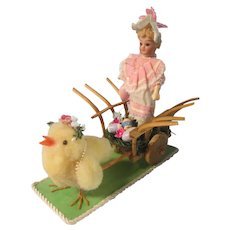 All original German bisque doll in an Easter cart