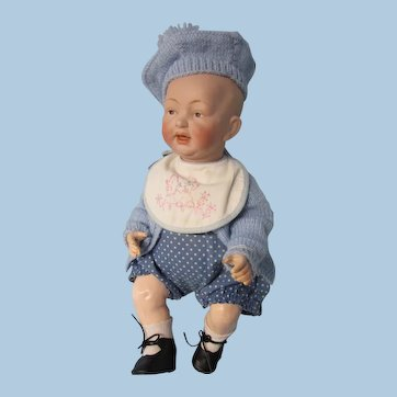 Painted eye German bisque baby, molded hair, 13""