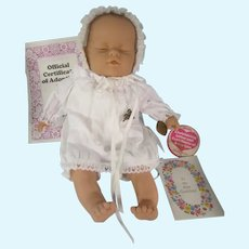 Lissi Sunny Child sleeping baby, with adoption certificate